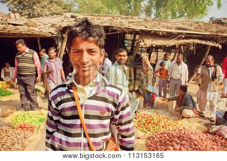 Unidentified Teenager Standing In Crowd Of Customers Of Village Vegetable Market In India