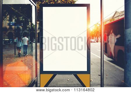 Public information board in urban setting, Lightbox on city bus stop