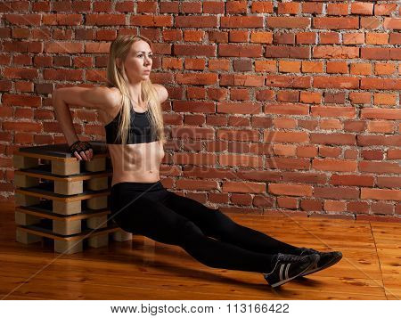 Athletic Woman Performing Push-ups Using The Box  At The Gym