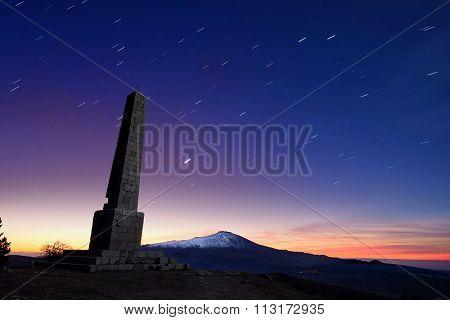 Etna Volcano and Nelson's Obelisk in the night stars at the crack of dawn, Nebrodi Park in Sicily