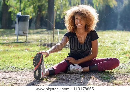 Fitness Black Woman Runner Stretching Legs After Run