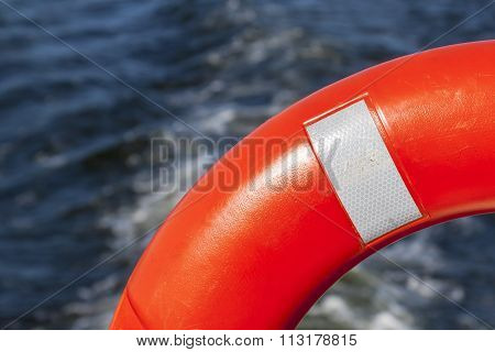 Lifebuoy in orange,  the rescuer on the river.