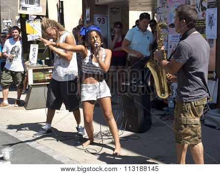 Woman singing in the street.