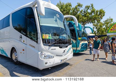 Local buses on bus terminal in Thira town.
