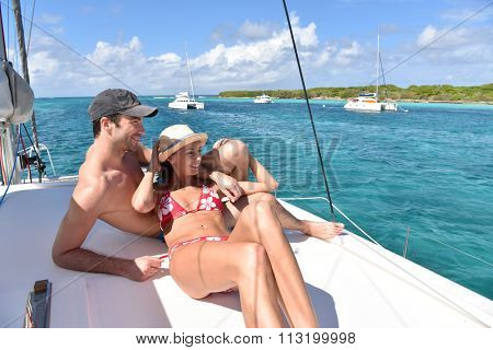 Couple relaxing on a cruising boat deck