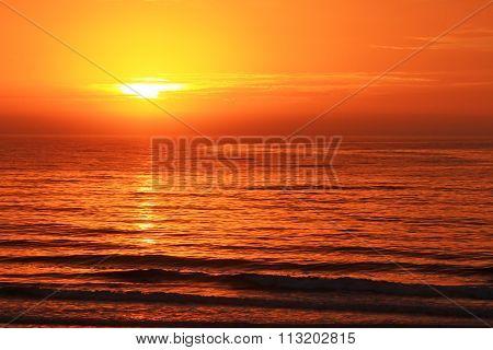 Early Morning Sunrise On Ocean