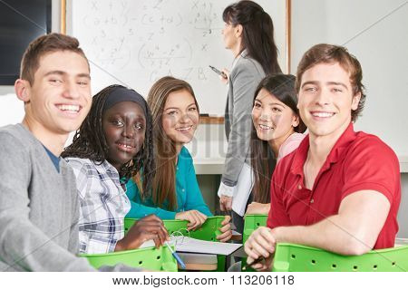 Interracial group of teenage students in math class
