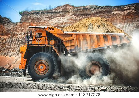 Loaded big yellow mining truck.