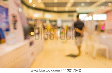 Blur Image Of People At Eletronic Department Store With Bokeh
