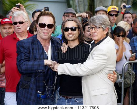 LOS ANGELES, USA - Mickey Rourke, Keaton Simons and Eric Roberts at the Mickey Rourke Hand And Footprint Ceremony held at Grauman's Chinese Theater in Hollywood, USA on October 31, 2011.