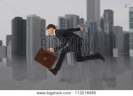 Businessman running with a briefcase. Business concept