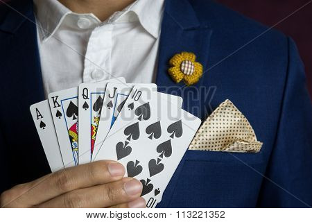 Man Holding Card Royal Straight Flush