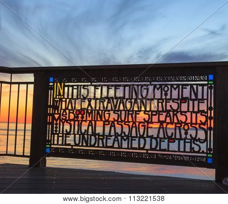 Stained glass fence at Brown's Park by artist Raymond Persinger in Laguna Beach, California at sunse