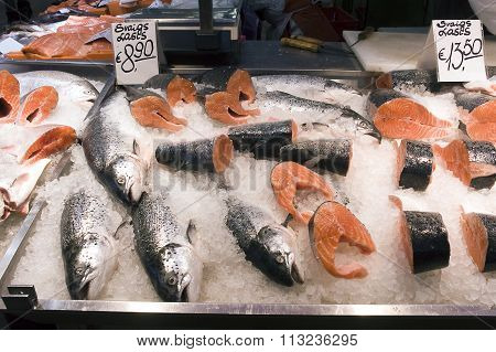 Riga. Sale Of A Salmon In Fish Pavilion On A Market.