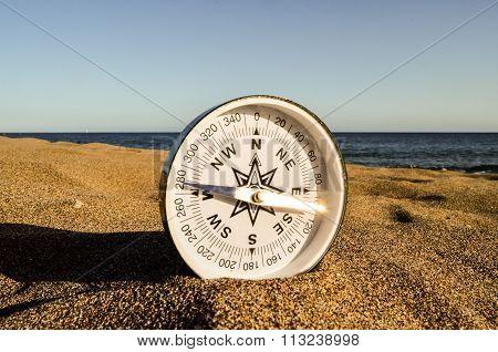 Compass on the Sand Beach