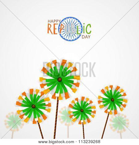 Creative pinwheels on grey background for Happy Indian Republic Day celebration.
