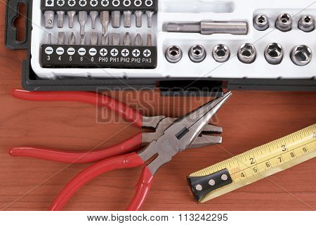 Screwdriver Toolbox With Set Of Bits, Pliers And Measuring Tape