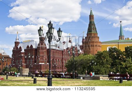 MOSCOW - AUGUST 21 2010: Historical museum on Manezhnaya square has been built in 1883 and tower of fortress Moscow Kremlin.