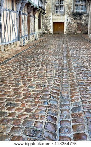 wet cobbled street in old town of Troyes