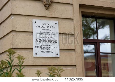 ST. PETERSBURG, RUSSIA - SEPTEMBER 19, 2015: Commemorative plaque in tribute to academician Abram Ioffe on the academic building of Peter the Great Saint-Petersburg Polytechnic University