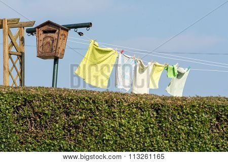 Laundry Hanging To Dry In A Garden