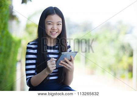 Portrait Of Asian Teen And Computer Tablet In Hand Use For Digital Lifestyle ,internet Wifi And On L