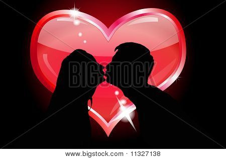 Silhouettes of lovers kissing