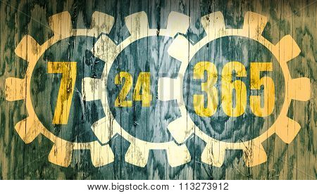 Timing Badge Symbol 7, 24, 365 On Wood Texture