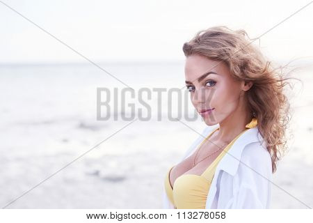 Portrait of a beautiful and sexy woman on the beach
