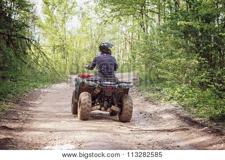 Man On The Atv Quad Bike.