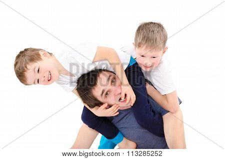 Dad having fun with sons