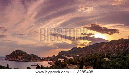 Paleokastritsa at sunset in COrfu Greece