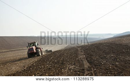 Harrowing the soil with disc harrows in spring in Ukraine. poster