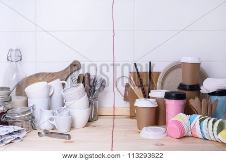 Kitchenware, ceramic and paper for on the go cups, on wooden tabletop, white background.
