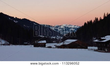 Pink Sky Over Wintery Landscape Near Gstaad