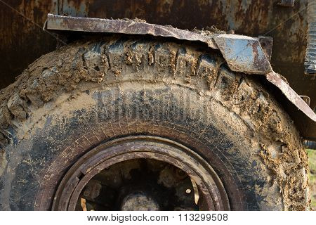 Muddy Wheels Of The Big Truck.