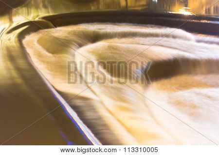 High water flow over Pulteney Weir in central Bath, Somerset, UK