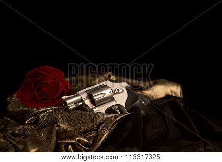 Revolver laying on Satin