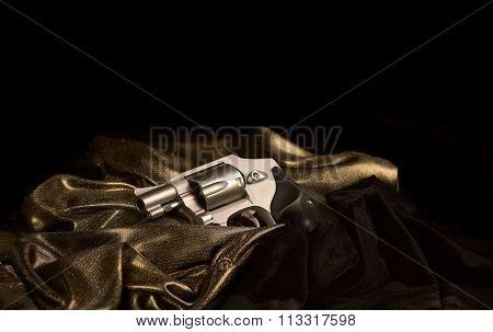 Snubnose Revolver On Gold Satin