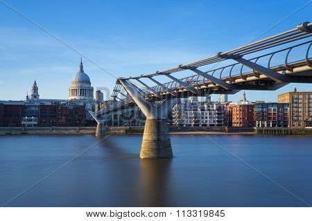 St Paul's Cathedral and Millennium Bridge in sunset, London, UK