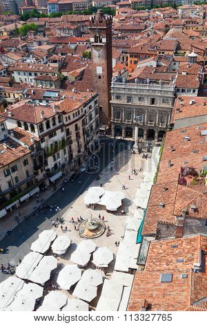 VERONA, ITALY - APRIL 26: aerial view of the Piazza delle Erbe with unidentified people on April 26, 2014 in Verona. The square in the UNESCO protected city was the towns forum in the Roman Empire.