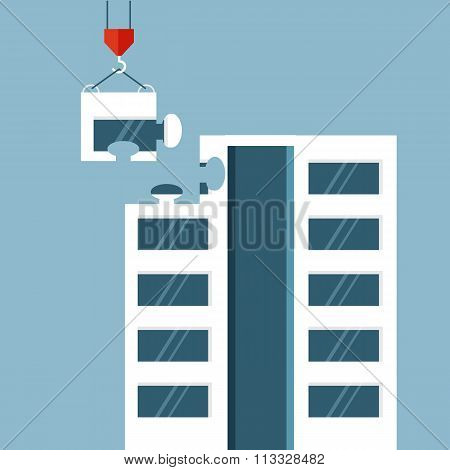 Construction of big building with puzzle detail on the hook