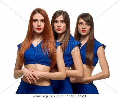 three long-haired women portrait. triplets sisters