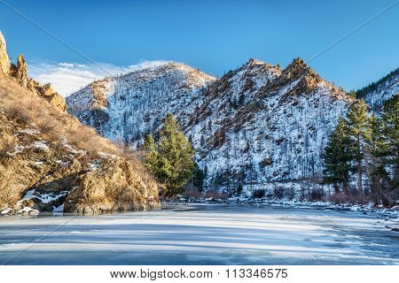 Canyon of Cache la Poudre River in northern Colorado west of Fort Collins, winter scenery with snow and long shadows