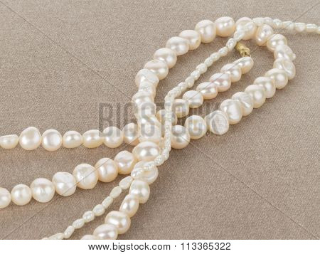 Beads Of Pearl On The Soft Velvet