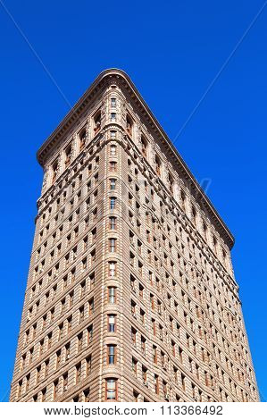 NEW YORK CITY - OCTOBER 10, 2015: Flatiron Building in Manhattan. Its a steel framed historical skyscraper, designated as NYC landmark and National Historic Landmark and registered in Historic Places