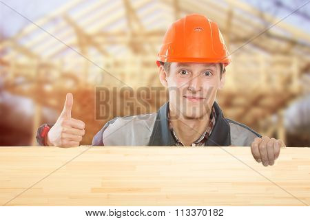 Builder On The Background Of The House Under Construction