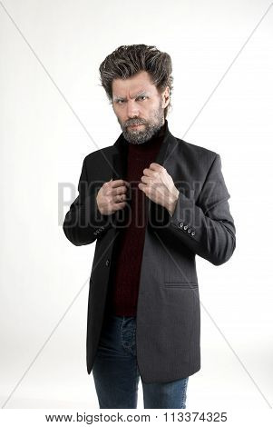 Mr. IceMan aggression, fashion man in knitted sweater and jacket.