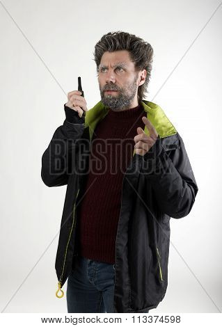 Mr. IceMan aggression, he talking on walkie-talkie. fashion man in knitted sweater and jacket.