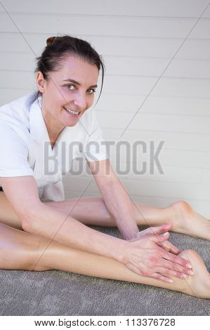The Beautician Who Massaging The Foot Of Her Patient